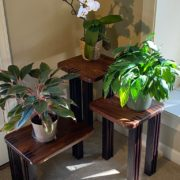 Figured Sapele wood with Wenge wood legs, in a multi-level platform for display or plants.