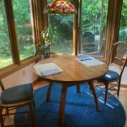 Chestnut wood from the siding of a home was used to make this table for a kitchen nook.